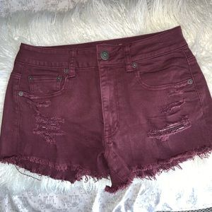 Distressed maroon jean shorts